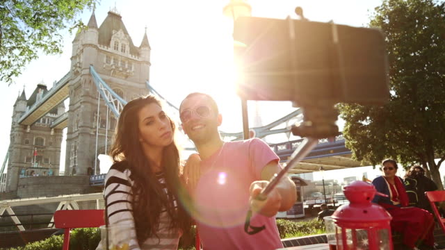 Couple takes a selfie stick in front of the Tower Bridge video