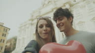Couple taking a selfie in Rome with heart video