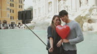 Couple taking a selfie stick in Rome with heart video