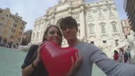 Couple taking a selfie video in Rome with heart video