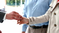 Couple taking keys from businessman video