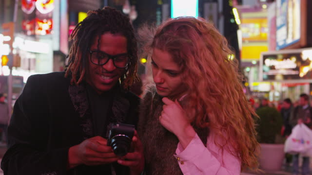 Couple taking photos together in Times Square video