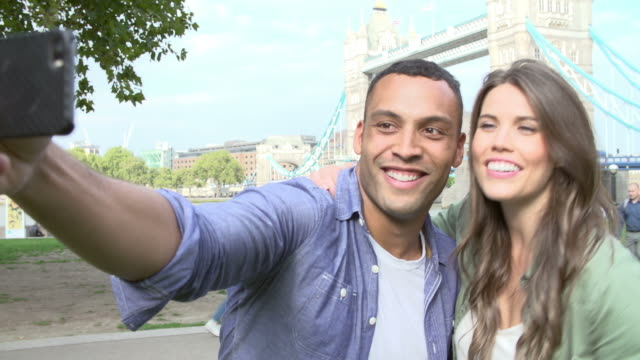 Couple Taking Selfie By Tower Bridge In London video