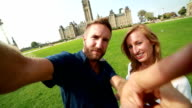 Couple taking selfie in front of Canadian Parliament video