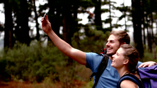 Couple taking selfie on a hike video