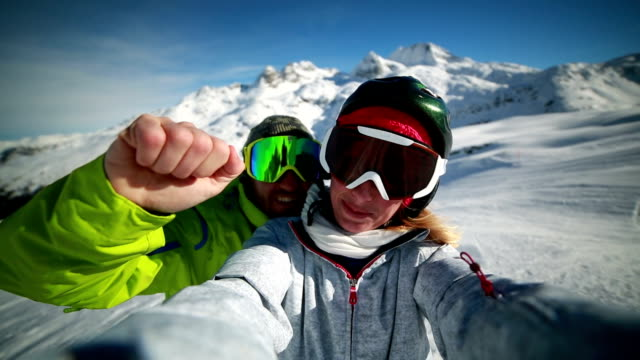 Couple taking selfie on ski slope video