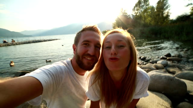 Couple taking selfies persona perspective video