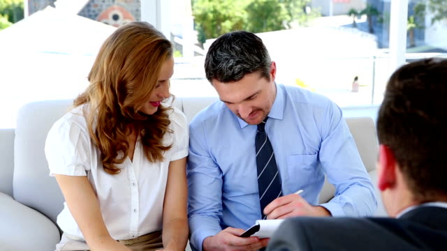 Couple talking to their financial advisor video