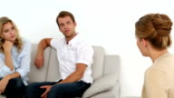 Couple talking with their therapist video