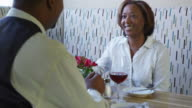 Couple toasts at restaurant video