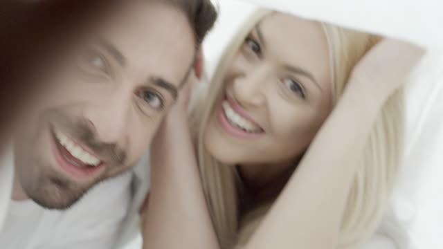 Couple under blanket video