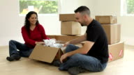 Couple unpacking boxes video