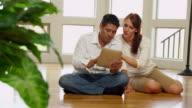 Couple using digital tablet together video