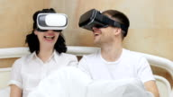 Couple using VR glasses. video