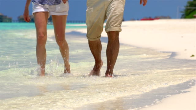 Couple Walk Along Beach. Close Up Of Feet and Waves. Slow motion. video