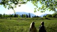 Couple walk under new aspen leaves video