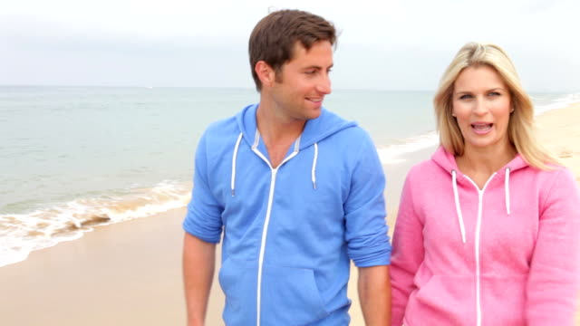 Couple Walking Along Beach Together video