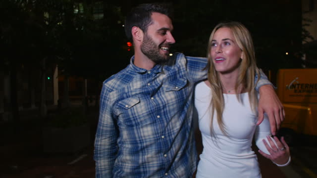 Couple Walking Along Street On Night Out video