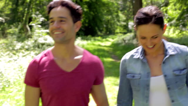 Couple Walking Along Summer Woodland Path Together video