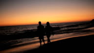 Couple walking at sunset video