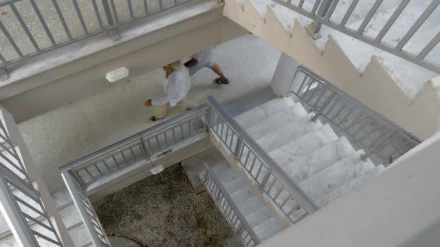 Couple Walking Down the Spiral Stairs video