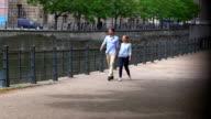 Couple walking near spree river video