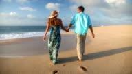 Couple Walking On Beach Enjoying Sunset Vacation On Romantic Honeymoon video