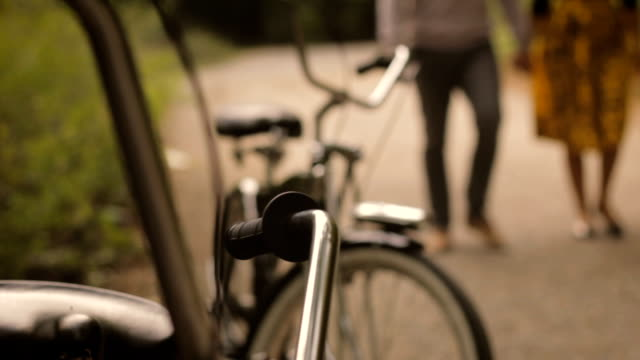 Couple walking toward bicycles video