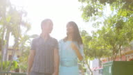 Couple walks through down together video