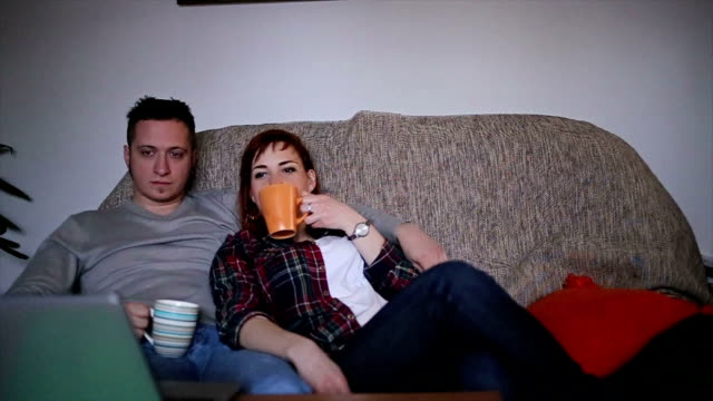 Couple watching movie at home video
