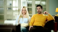 Couple watching TV together. video