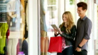 Couple window shopping with tablet video