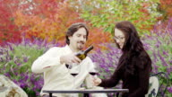 Couple wine tasting outside at winery video