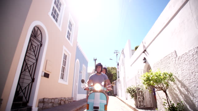 Couple with a scooter on a road trip vacation video