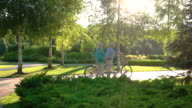 Couple with bicycle is walking. video