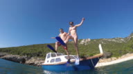 POV Couple with diving masks jumping off a boat into the sea video