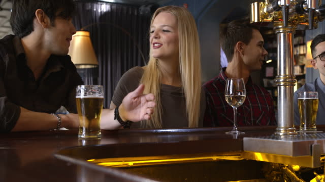 Couple with friends drinking at the bar counter video