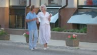 Couple with ice cream walking. video