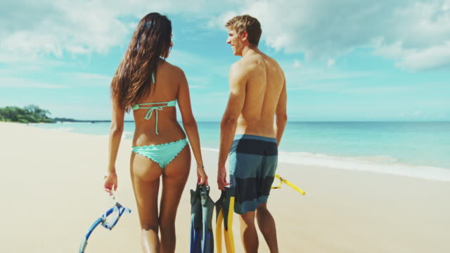 Couple with Snorkel Gear on Beach video