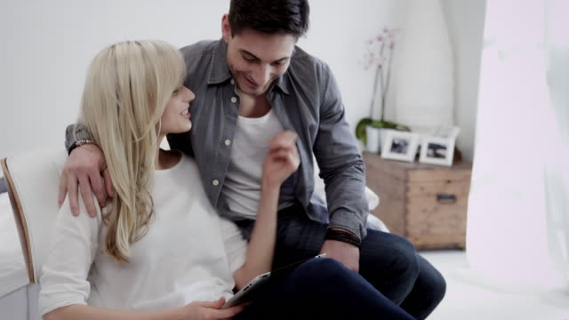 Couple with tablet pc video