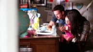Couple With Young Daughter Running Business From Home video