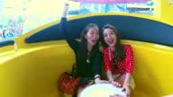 Couple woman enjoy playing at amusement park. video
