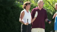 Couples greet each other at the golf course. video