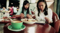 Couples woman enjoy and eating food in the coffee shop video