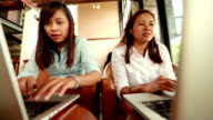 Couples woman using computer in the coffee shop, Slow motion video
