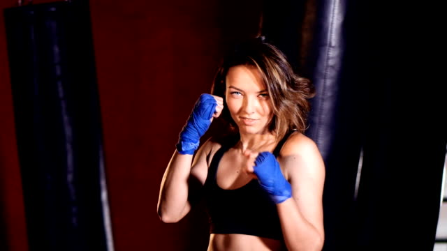 Courageous woman motioning with her hand in boxing studio. video