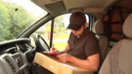 Courier / Delivery man in Van - HD & PAL video