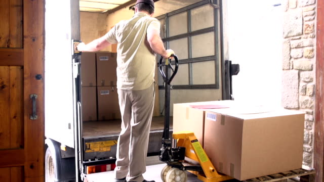 Courier / Delivery man loading Pallet into Truck video