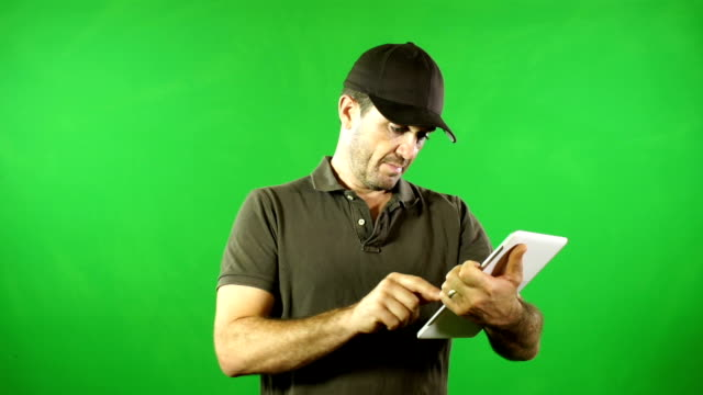 Courier / Delivery man Using Digital Tablet Green Screen video