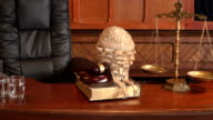 4K DOLLY: Courtroom bench with Barrister / Judge Wig video